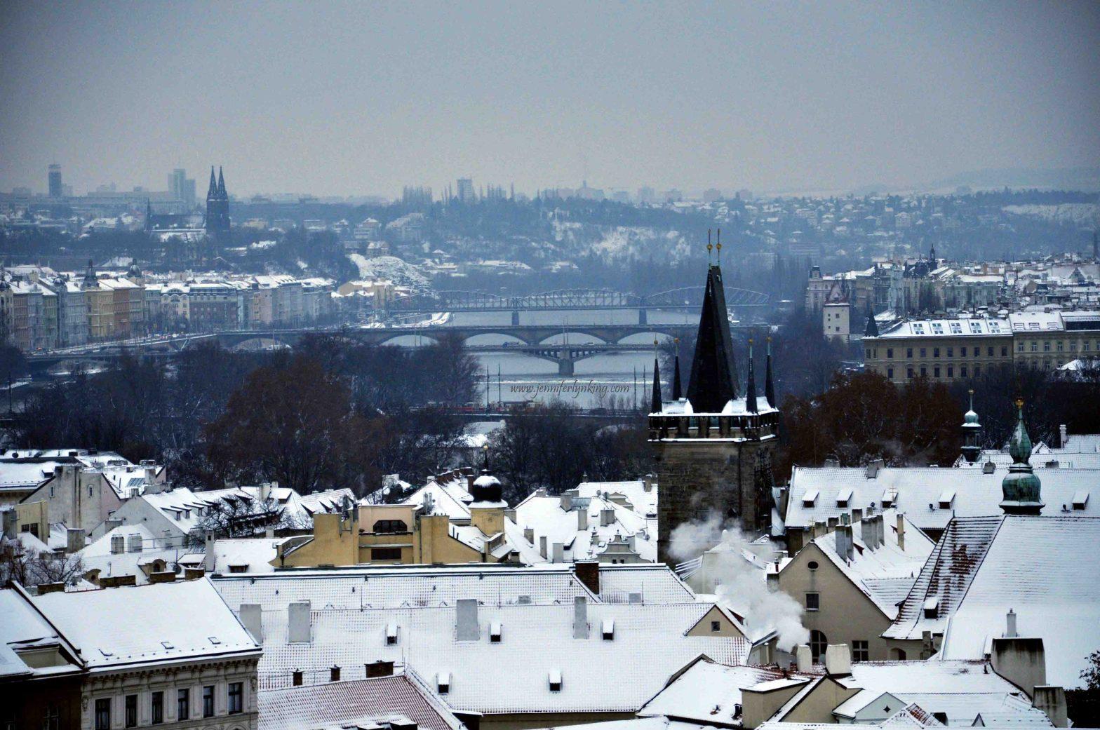 Prague's Spires and Bridges with Snow in Winter