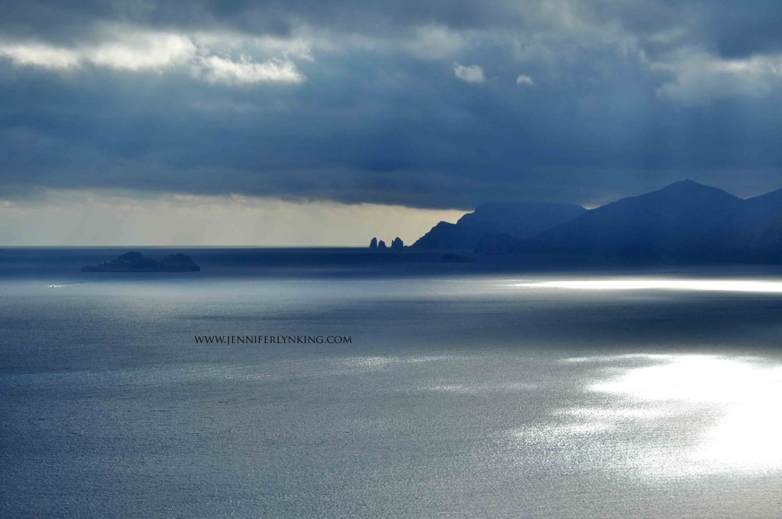 Dark Seas across the view from Praiano to the Faraglioni and Isle of Capri, Italy