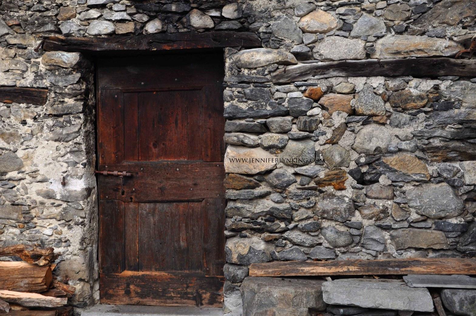 Stone village, chestnut door, Italian Alps